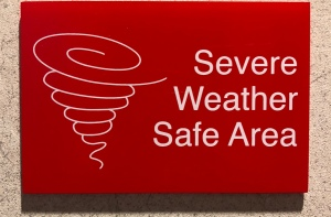 Sign for a weather shelter