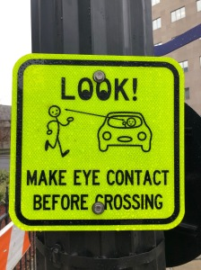 Make Eye Contact Before Crossing Sign